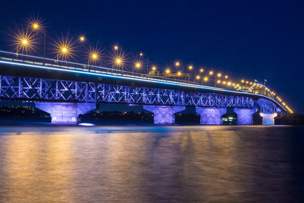 The Lighting  Of Auckland Harbour Bridge Artists Help Shine A Light On Family Violence